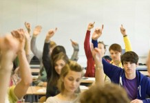 boy raising hand in class